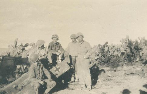 Head Kreidler and Lt. Meritt with pieces of ME109, Tunisia, North Africa 1943 125.0159.1.jpg